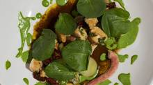 Model Milk executive chef and co-owner Justin Leboe's octopus dish at his restaurant in Calgary Nov. 13, 2012. (Todd Korol for The Globe and Mail)