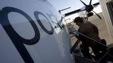 A passenger boards a Porter flight in Toronto. (Peter Power/Peter Power/The Globe and Mail)
