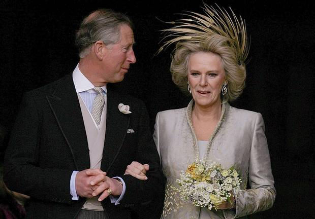 Prince Charles and The Duchess of Cornwall leave St. George's Chapel in Windsor Castle, southern England, following the Service of Prayer and Dedication following their marriage, April 9, 2005.