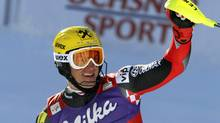Croatia's Ivica Kostelic celebrates after winning an alpine ski, men's World Cup slalom, in Wengen, Switzerland, Sunday. (Marco Trovati)