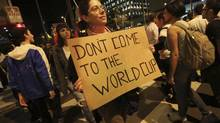 A demonstrator holds a sign during a protest in Sao Paulo on June 17, 2013. Next year, Brazil hosts the World Cup, and many in the country's emerging middle class have protested the event's cost. (NACHO DOCE/REUTERS)