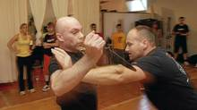 Instructors Billy Austin (L) and Christopher Gagre teach Krav Maga, a form of self defense that originates in Israel, to a class at Wu Xing Martial Arts, Toronto Ontario August 26, 2010. (Fernando Morales/Fernando Morales/The Globe and Mail)