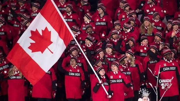 Canadian ice dance team Tessa Virtue and Scott Moir lead team Canada into the Olympic stadium as the flag bearers during the opening ceremonies at the 2018 Winter Olympic Games in Pyeongchang, South Korea, on Friday, February 9, 2018. THE CANADIAN PRESS/Nathan Denette