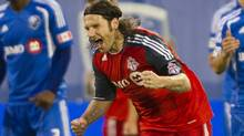 Toronto FC midfielder Torsten Frings (22) celebrates after scoring the first goal in a 3-0 victory over the Montreal Impact during second half Major League Soccer action in Montreal on Wednesday, June 27, 2012. (The Canadian Press)