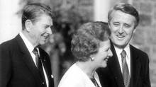 U.S. President Ronald Reagan, British Prime Minister Margaret Thatcher and Prime Minister Brian Mulroney chat at a G7 leaders' summit on June 20, 1988. (Hans Deryk)
