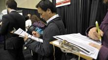 Hundreds line up for various booths at a job fair in Toronto earlier this year. (J.P. MOCZULSKI For The Globe and Mail)