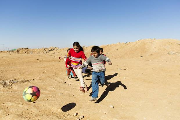 Children play soccer at Zaatari refugee camp in Jordan on Dec. 12, 2015.