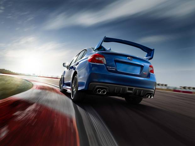 The STI sports an optional rear wing.
