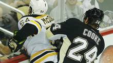 Pittsburgh Penguins' Matt Cooke (R) checks Boston Bruins' Adam McQuaid from behind resulting in a five minute major penalty during the second period of Game 1 of their NHL Eastern Conference finals hockey playoff series in Pittsburgh, Pennsylvania June 1, 2013. (BRIAN SNYDER/REUTERS)