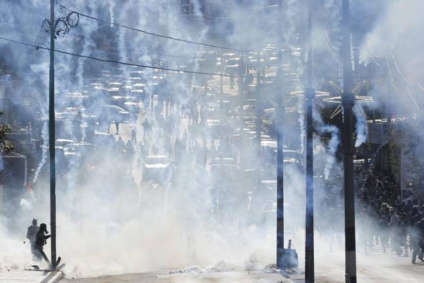 Israeli troops fire teargas towards Palestinians during a protest against U.S. President Donald Trump's decision to recognize Jerusalem as the capital of Israel in the West Bank city of Bethlehem on Dec. 7, 2017.