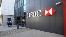 Customers leave a HSBC branch in Dubai in a file photo. London-based HSBC could make about $1.4-billion from the sale of its Panama assets, as the business is being sold at three times its estimated net asset value of $700-million (U.S.). (NIKHIL MONTEIRO/REUTERS)