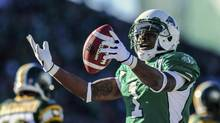 Saskatchewan Roughriders running back Kory Sheets celebrates after scoring a touchdown during the first half of their CFL game against the Edmonton Eskimos in Regina, Saskatchewan October 12, 2013. (STRINGER/CANADA/Reuters)