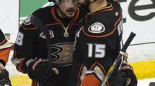 Anaheim Ducks right wing Teemu Selanne, left, gets a hug from center Ryan Getzlaf after they were defeated by the Los Angeles Kings in Game 7 of an NHL hockey second-round Stanley Cup playoff series on May 16, 2014, in Anaheim. (Mark J. Terrill/AP)