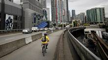 Traffic including a cyclist head into downtown along the Dunsmuir Street Viaduct adjacent to the Georgia Street Viaduct in Vancouver, British Columbia on Wednesday, June 6, 2012. (Rafal Gerszak for the Globe and Mail)