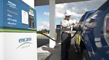 An employee fills up his natural gas truck at Encana's compressed natural gas fueling station in Louisianas Red River Parish. (GlenEllman/Encana)