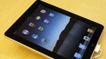 An Apple iPad is displayed during an iPad launch event at the Apple retail store in San Francisco, California April 3, 2010. Apple Inc's iPad hit store shelves on Saturday after months of intense buzz, giving shoppers their first chance to decide whether the tablet device is worth all the breathless publicity. (ROBERT GALBRAITH/REUTERS/Robert Galbraith)