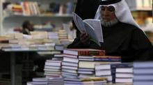 A man browses at the Riyadh International Book Fair in this March 6, 2012 file photo. Bookstore chain Jarir has grown from a single store on a Riyadh street in 1979 into a chain with 32 stores in the kingdom. (FAHAD SHADEED/REUTERS)
