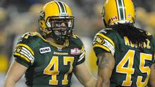 Edmonton Eskimos' JC Sherritt, 47, celebrates getting the CFL record for most tackles in a season against the Calgary Stampeders during second half CFL action at Commonwealth Stadium in Edmonton on Friday, Nov. 2, 2012. (Ian Jackson/THE CANADIAN PRESS)