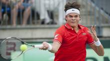 Milos Raonic from Canada returns the ball to Nikala Scholtz from South Africa during Davis Cup tennis action in Montreal, Friday, September 14, 2012. (The Canadian Press)