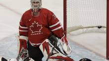 Martin Brodeur lost his position as Canada's starting goaltender following a 5-2 preliminary-round loss to the United States at the 2010 Winter Olympics in Vancouver. (Peter Power/Peter Power/The Globe and Mail)