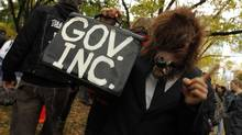 A protester gets creative at the Occupy Toronto protests on October 15, 2011. (Peter Power/ The Globe and Mail/Peter Power/The Globe and Mail)
