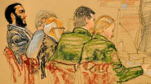 A courtroom sketch of Omar Khadr, left, during jury selection at his military trial at Guantanamo Bay, Cuba, on Aug. 10.