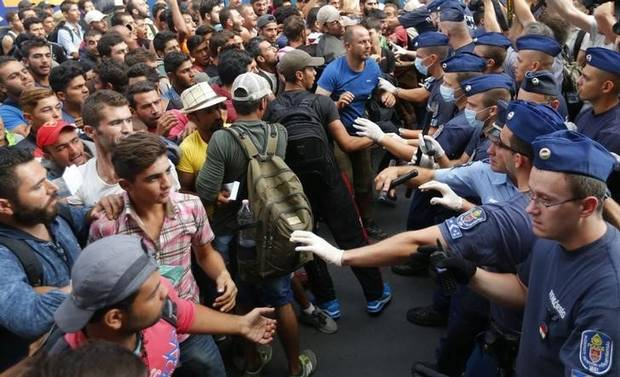 Migrants face Hungarian police in the main Eastern Railway station in Budapest on Sept. 1, 2015.