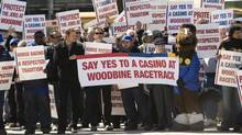Woodbine Mohawk employees show their support of a casino at the racetrack in front of Toronto City Hall on April 15, 2013. (Michael Burns)