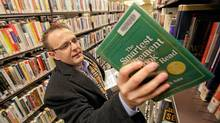 Stephen Murdoch, 37, pores over financial books in a library in St. Catharines, Ont. (glen lowson/the globe and mail/glen lowson/the globe and mail)