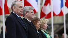 French Prime Minister Jean-Marc Ayrault, left; Prime Minister Stephen Harper; Mr. Ayrault's wife Brigitte; and Laureen Harper at an official ceremony Wednesday. (BLAIR GABLE/REUTERS)