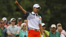 Amateur Guan Tianlang of China gestures after hitting his tee shot (BRIAN SNYDER/REUTERS)