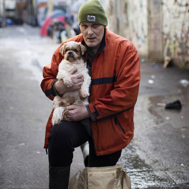 Robert Dumas and his dog Chico are photographed in Vancouver's Downtown Eastside, British Columbia, Friday, December 22, 2017.
