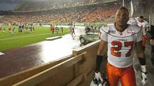 B.C. Lions' JR LaRose, right, watches as fans look for cover as lightening, heavy rain and high winds temporarily halt the Edmonton Eskimos Lions game during first half CFL action in Edmonton Friday July 30, 2010. (John Ulan/THE CANADIAN PRESS)