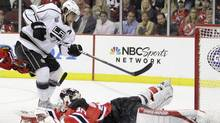 Los Angeles Kings' Anze Kopitar, of Slovenia, scores past New Jersey Devils'