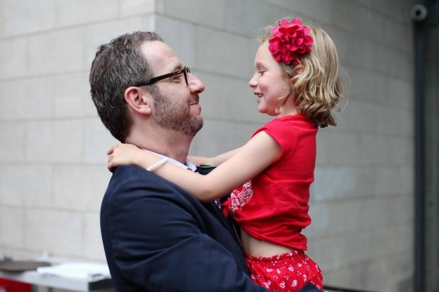 Mr. Butts shares a moment with Ella-Grace Trudeau in 2014, and left, takes a moment to check his phone while sitting with Sophie Grégorie Trudeau and Ella-Grace's brother Xavier.