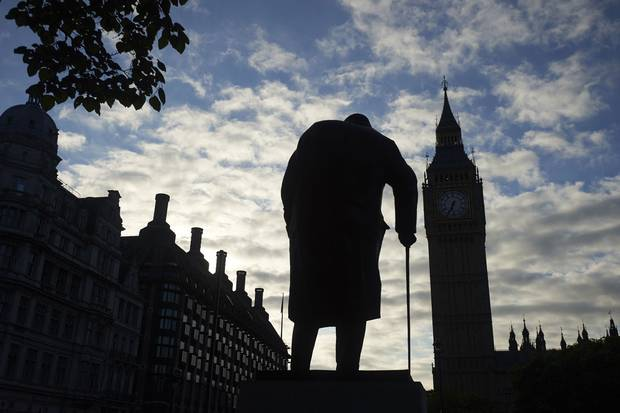 The statue of Winston Churchill faces Big Ben and the Houses of Parliament in central London.