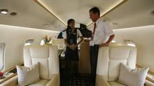 Crew chat inside the cabin of a Bombardier Challenger 850 (BOBBY YIP/REUTERS)