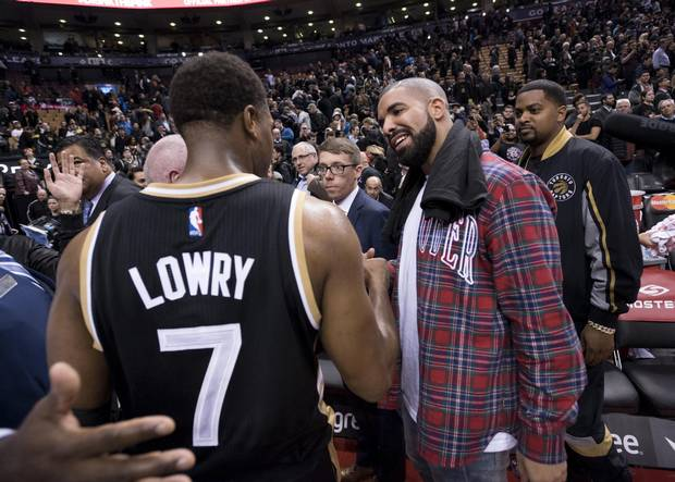 Drake, right, celebrates with Kyle Lowry of the Raptors after Toronto beat the Cleveland Cavaliers on the third annual Drake Night at the Air Canada Centre.