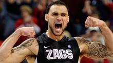 North Vancouver's Robert Sacre of the Gonzaga Bulldogs celebrates his team's 75-63 victory over the Saint Mary's Gaels in the the championship game of the West Coast Conference Basketball tournament at the Orleans Arena March 7, 2011 in Las Vegas, Nevada. (Photo by Ethan Miller/Getty Images) (Ethan Miller/2011 Getty Images)