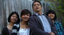The Claver family who migrated to Canada five years ago from the Philippines from left to right, Cassandra, 16, Samantha,17, Chandu and Alexandra,13 in their backyard in Victoria, BC. (Chad Hipolito/The Globe And Mail/Chad Hipolito/The Globe And Mail)