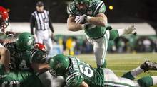 Saskatchewan Roughriders' fullback Chris Szarka jumps in across the line for a touchdown while playing against the Calgary Stampeders during the second half of CFL football action in Regina, Saskatchewan November 7, 2009. Saskatchewan won the game 30-14, making it the first time the Roughriders finished the season in first place in the western division. REUTERS/David Stobbe (DAVID STOBBE)