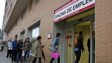 People enter an unemployment office in Madrid Tuesday April 3, 2012. The number of people filing for unemployment benefits in Spain rose by nearly 39,000 last month to a little over 4.75 million. (Paul White/AP/Paul White/AP)