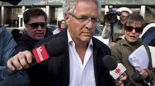 Quebec construction magnate Tony Accurso leaves the Quebec Provincial Police headquarters after being arrested for charges of fraud in Montreal on April 17, 2012. Quebec construction magnate Tony Accurso has been arrested for the second time as police continue to crack down on alleged corruption in the industry. (Paul Chiasson/THE CANADIAN PRESS)