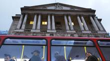 A bus passes the Bank of England in the city of London on Nov. 26, 2012. Britain named Canadian central bank chief Mark Carney as the next governor of the Bank of England. (Olivia Harris/Reuters)