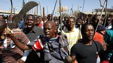 Mine workers take part in a march at Lonmin's Marikana mine in South Africa's North West Province September 10, 2012. (SIPHIWE SIBEKO/REUTERS)