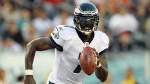 Michael Vick of the Philadelphia Eagles runs the ball against the Baltimore Ravens during their preseason game on August 11, 2011 at Lincoln Financial Field in Philadelphia, Pennsylvania. (Jim McIsaac/Getty Images)
