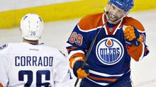 Edmonton Oilers' Sam Gagner, 89, celebrates a goal during first period preseason NHL action in Edmonton, Alta., on Saturday September 21, 2013. Gagner was injured later in the game and will miss the start of the regular season with a broken jaw. (JASON FRANSON/THE CANADIAN PRESS)