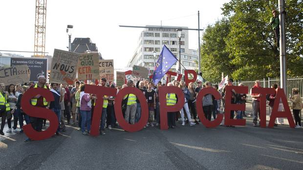 Protesters hold an anti-CETA banner during a demonstration against international trade agreements in Brussels on Sept. 20, 2016.