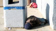The capital of Nunavut, Iqaluit, is outraged over this picture of two young boys sleeping on the street outside a local grocery store on July 26, 2009. (Evie Eegeesiak)