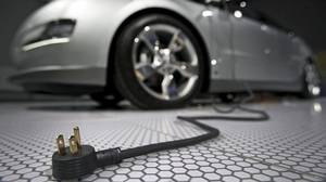 A plug is seen coming from the Chevrolet Volt electric car during the North American International Auto Show in Detroit on Jan. 13, 2009.